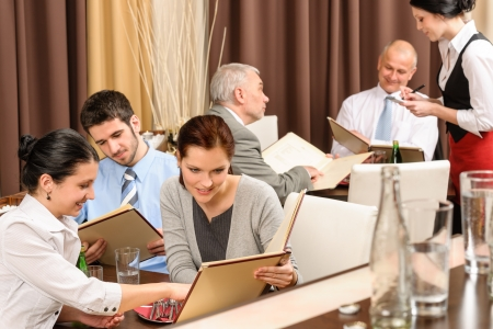 ordering: Business lunch executive people looking menu  ordering meal at restaurant Stock Photo