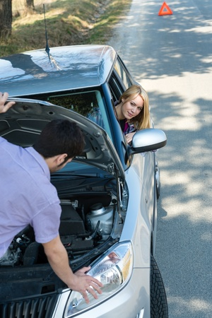 Car troubles couple starting broken vehicle on the road Stock Photo - 13152504