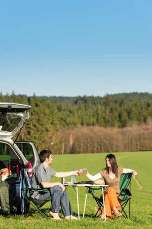 Camping car happy young couple toasting enjoy picnic sunny countryside photo