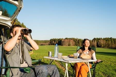 Camping car happy couple man looking telescope relax countryside picnic photo