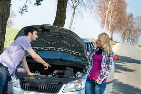 Car breakdown couple calling for road assistance man point engine Stock Photo - 13165928