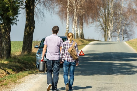 petrol can: Fill up petrol couple with car trouble carry gas can Stock Photo