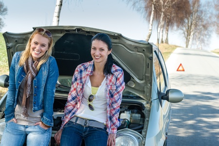 Car failure two young women waiting for help road assistance Stock Photo - 13165924