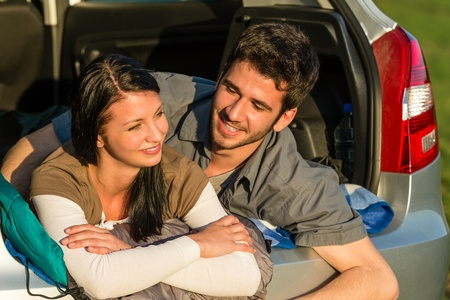 Camping young couple hugging together in car summer sunset Stock Photo - 13165921