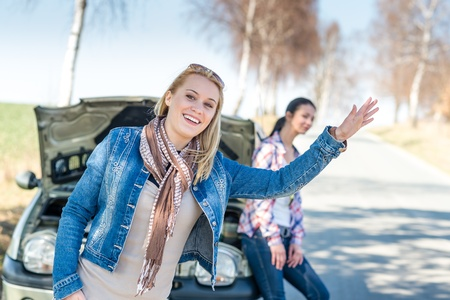 Car failure two young women waiting for help road assistance Stock Photo - 13258499