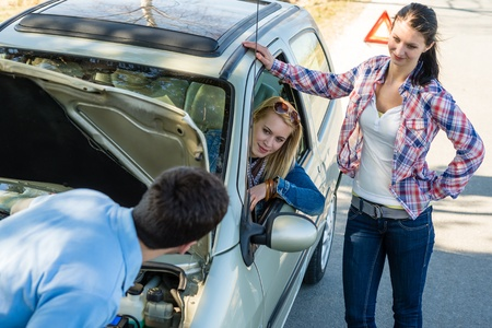 Car failure man help two female friends repair motor Stock Photo - 13258551