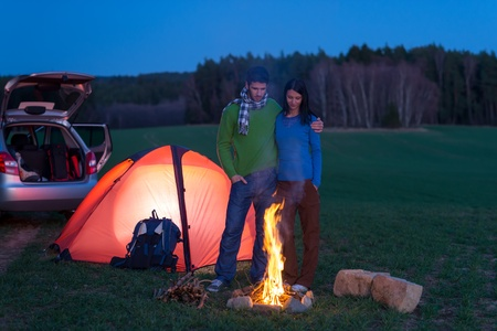 Tent camping car couple romantic stand by bonfire night countryside photo