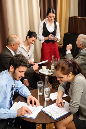 ordering: Business people have company meeting at restaurant waitress ordering Stock Photo