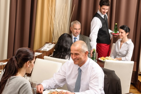 Business people enjoy lunch meal at restaurant management discussion photo