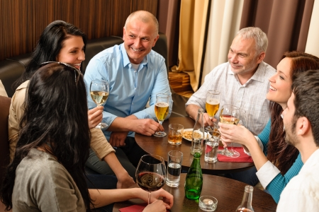 pub: Drink after work happy colleagues having fun at fancy restaurant