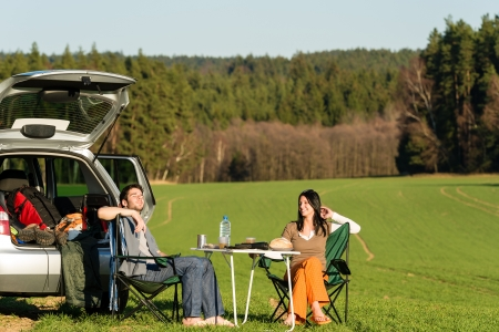 Camping car happy young couple enjoy picnic sunny countryside Stock Photo - 13258734