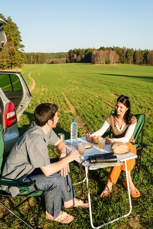 Camping car happy young couple enjoy picnic sunny countryside photo