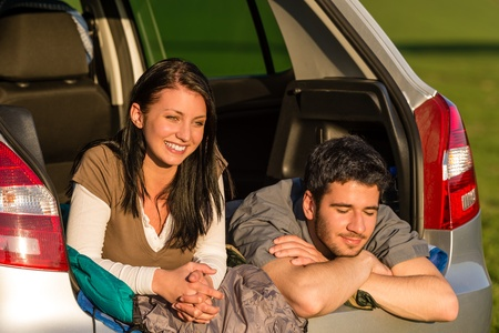 Camping young couple hugging together in car summer sunset Stock Photo - 13215825
