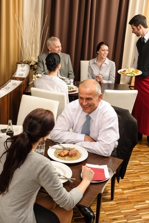 Business people enjoy lunch meal at restaurant management discussion Stock Photo - 13242044