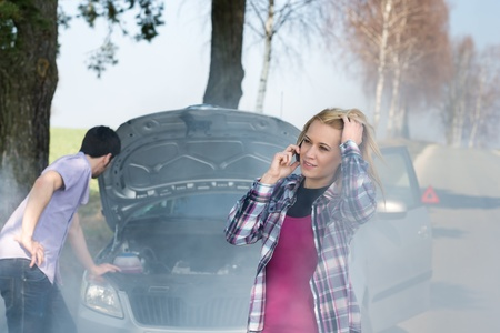 Car breakdown woman call for help road assistance smoking engine Stock Photo - 13242005