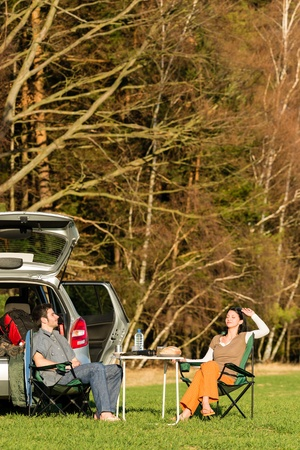 Camping car happy couple enjoy sun relax picnic in countryside photo