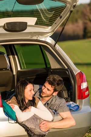 Camping young couple hugging together in car summer sunset Stock Photo - 13242025