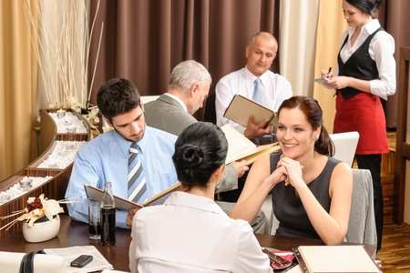 Business lunch executive people looking menu  ordering meal at restaurant photo