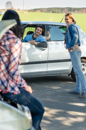 Car troubles two woman friends asking help young man Stock Photo - 13260090