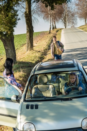 Young man road trip girl friends offer lift with car photo