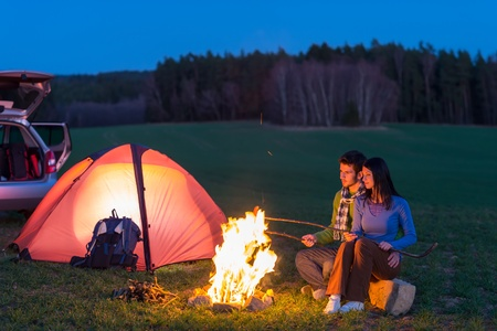 bonfire night: Tent camping car couple romantic sitting by bonfire night countryside