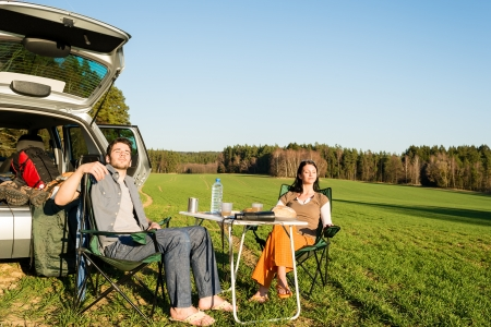 Camping car happy couple enjoy sun relax picnic in countryside Stock Photo - 13340938