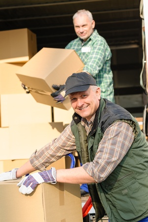 Male mover loading van with cardboard box delivery service Stock Photo - 13318854