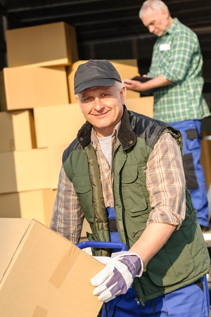 Male mover loading van with cardboard box delivery service photo