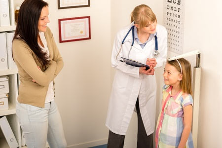 Medical examination at pediatrist girl measure height and weight