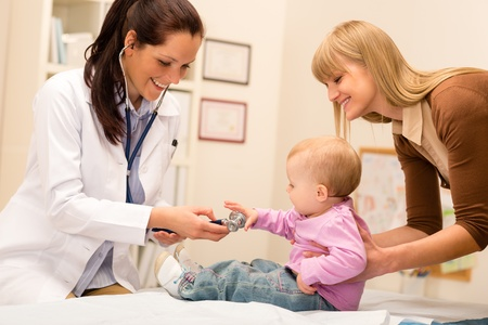 Cute baby being examine by pediatrician with stethoscope Stock Photo - 13488218