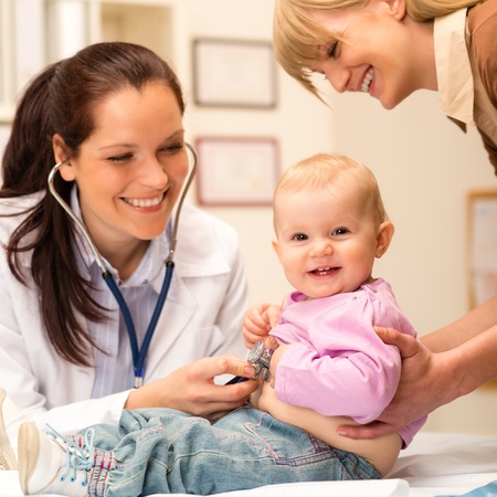 doctor female: Cute baby being examine by pediatrician with stethoscope