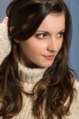 Portrait of young brunette winter woman wearing beige sweater Stock Photo - 13556251