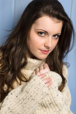 Portrait of young beautiful woman wearing winter beige sweater Stock Photo - 13556248