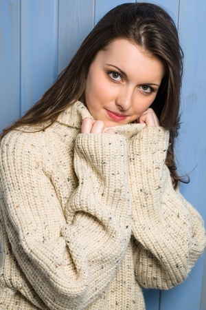 Beautiful smiling winter woman wearing beige sweater portrait Stock Photo - 13556284