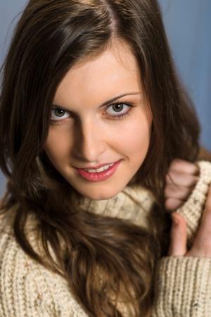 Beautiful smiling winter woman wearing beige sweater portrait Stock Photo - 13563737