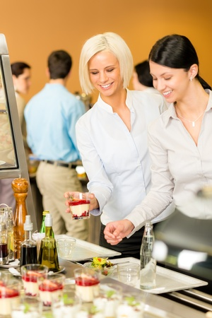cafeteria tray: Cafeteria food young woman look dessert selection serving tray Stock Photo