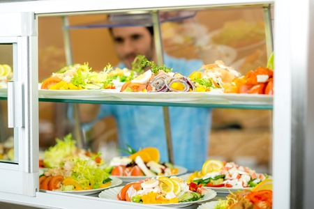 self service: Cafeteria food display young man choose fresh salad healthy lifestyle