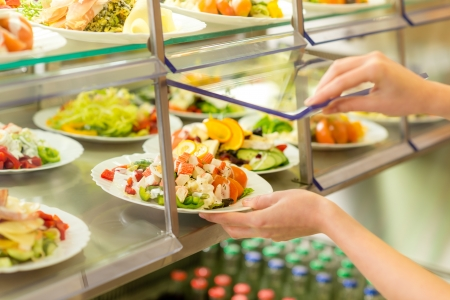 cafeteria tray: Fresh salad buffet self-service food display human hand take plate