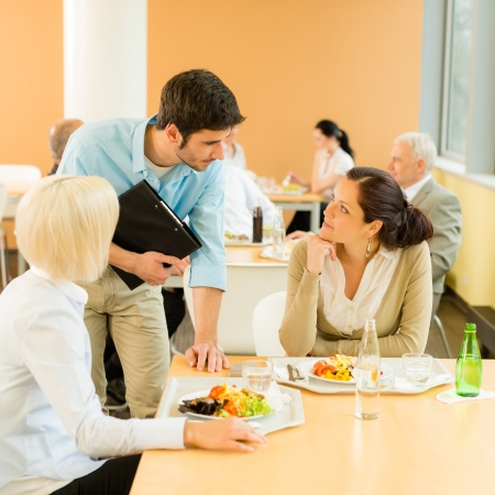 buffet table: Lunch break office colleagues eat meal in cafeteria fresh salad