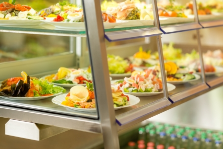 canteen: Canteen self-service food display plate with fresh made salad Stock Photo