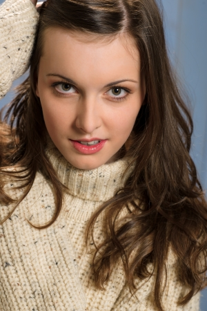 Portrait of young beautiful woman wearing winter beige sweater Stock Photo - 13627920
