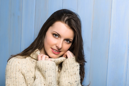 Beautiful smiling winter woman wearing beige sweater portrait Stock Photo - 13630935
