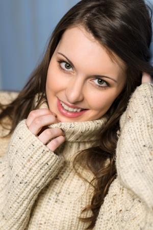 Beautiful smiling winter woman wearing beige sweater portrait Stock Photo - 13630879