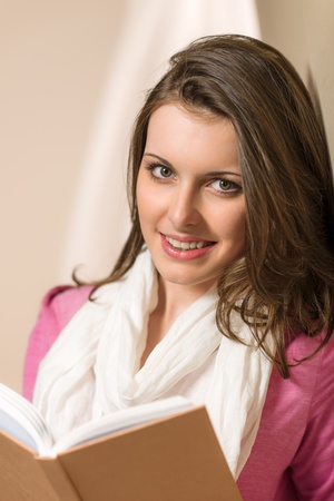 Young brunette woman hold student book wear pink jumper Stock Photo - 13630758
