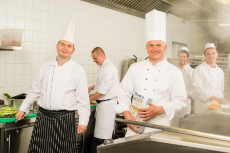 Professional kitchen busy team cooks and chef prepare meal photo