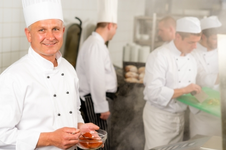 canteen: Professional kitchen smiling chef cook add spice paprika prepare food meals