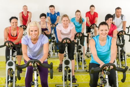 Spinning class group of young people at the gym