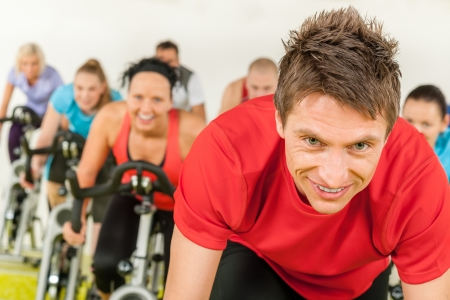 spinning: People spinning in gym or fitness club exercise cardio training Stock Photo
