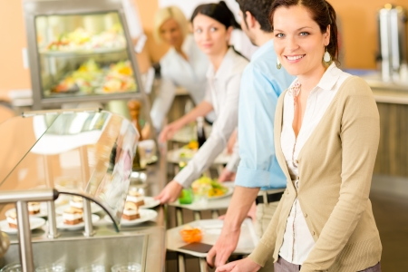 self service: Business woman take cafeteria lunch smiling self service buffet food