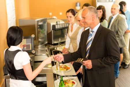 break fast: Cafeteria man pay by credit card cashier food on serving tray